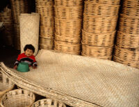 Oaxaca, boy with woven baskets and mats, 1982 or 1985
