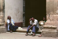 Oaxaca, people waiting by building, 1982 or 1985