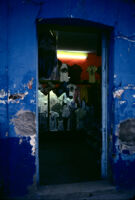 Oaxaca, doorway into clothing store, 1982 or 1985
