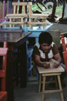 Oaxaca, boy and student desks, 1982 or 1985