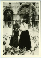 Gertrude Stein and Alice B. Toklas feeding pigeons in Venice, Italy, 1908