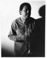 Bobby Bradford at home, 1983 [descriptive]
