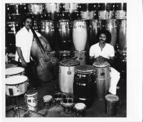 Roberto Miranda and Virgilio Figueroa at Gon-Bop drum factory [descriptive]
