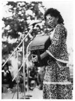 Queen Ida playing an accordion in San Francisco, 1978 [descriptive]
