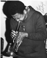 Autographed photo of Bobby Bradford playing trumpet, 1976 [descriptive]