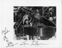 Autographed photograph of Toshiko Akiyoshi and Lew Tabackin at Barnsdall Art Park in Los Angeles, 1977 [descriptive]