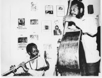 Jimmy and Percy Heath in The Barn, dressing room at the University of Redlands, 1980 [descriptive]
