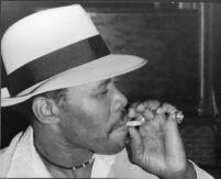 Mississippi Smokey Wilson smoking a cigarette, 1978 [descriptive]