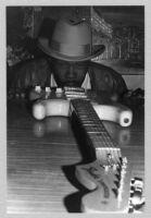 Smokey Wilson posing with guitar, 1978 [descriptive]
