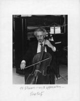 Autographed photo of Fred Katz playing the cello, 1979 [descriptive]