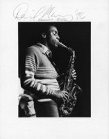 Autographed photo of David Murray playing saxophone, 1977 [descriptive]