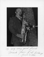 Autographed photo of Red Holloway playing saxophone, 1977 [descriptive]