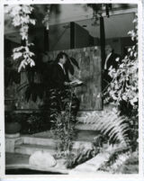 Richard J. Neutra and son, Dion outside house looking at plans [view 2]