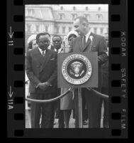 President Lyndon B. Johnson at podium looking towards Upper Voltian President Maurice Yaméogo, 1965 [11_1]