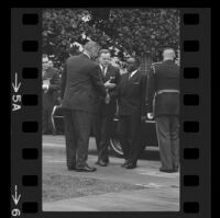 President Lyndon B. Johnson and Upper Voltian President Maurice Yaméogo shaking hands, 1965 [5A]
