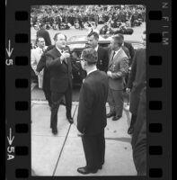 Hubert Humphrey Jr., astronauts Gus Grissom and John Young exiting automobile, 1965 [5_1]
