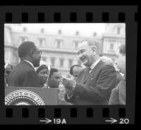 President Lyndon B. Johnson and Upper Voltian President Maurice Yaméogo facing each other, 1965 [19A]