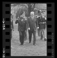 President Lyndon B. Johnson and Upper Voltian President Maurice Yaméogo waving, 1965 [15A]