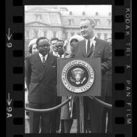 President Lyndon B. Johnson at podium with Upper Voltian President Maurice Yaméogo, 1965 [9_1]