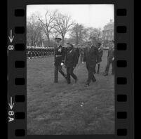 President Lyndon B. Johnson, Upper Voltian President Maurice Yaméogo and General walking, 1965 [8_2]