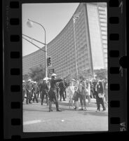 Police block pedestrians during President Johnson's visit at Century Plaza, 1967