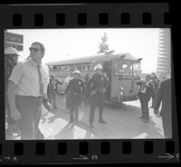 Police around bus at Avenue of the Stars during President Johnson's visit, 1967