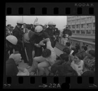 Police grabs protester at Century Plaza Hotel during Pres. Johnson's visit. 1967.