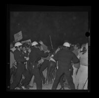 Police and protesters clash on Avenue of the Stars during a President Johnson-attended fund-raiser, 1967.