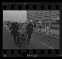 Protester dragged by police on Avenue of the Stars outside of Century Plaza Hotel, where President Johnson is speaking. A. 1967.