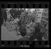 Sit-in in front of Century Plaza Hotel where President Johnson is speaking inside. 1967.