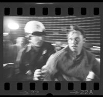 Protester pushed by police outside of Century Plaza Hotel where President Johnson is inside. 1967.