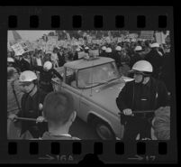 Truck in the middle of demonstration outside of the Century Plaza Hotel during President Johnson's visit. B. 1967.