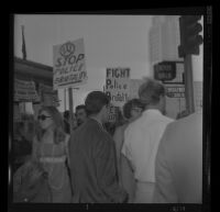 Protester Janet King at the Hall of Justice in downtown Los Angeles talks to pickets after being arraigned on felony charges stemming from the demonstration at Century Plaza during President Johnson's visit. A. 1967.