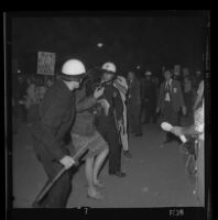 Woman arrested for ignoring police demands to disperse during a demonstration at Century Plaza at the time of President Johnson's visit, 1967.