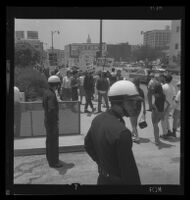 Protesting in front of police headquarters in response to police conduct at Century Plaza demonstration during President Johnson's visit, 1967.