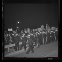 Protesters near Century Plaza meet a police barrier during President Johnson's visit, 1967