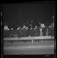 Police push protesters back near Century Plaza at demonstration during President Lyndon Johnson's visit, 1967.