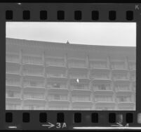 Security atop Century Plaza Hotel as onlookers on balconies await President Johnson's arrival, 1967.