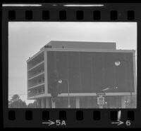 Police atop building near Century Plaza awaiting President Johnson's arrival, 1967.