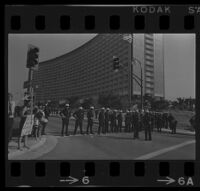 Police and Protesters await President Johnson's arrival at Century Plaza. 1967.