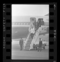 President Johnson and daughter Lynda Bird deboard Air Force One, 1967.