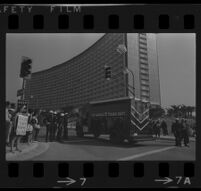 Patrol wagon parked in front of Century Plaza Hotel in anticipation of anti-War demonstration accompanying President Johnson's visit, 1967.
