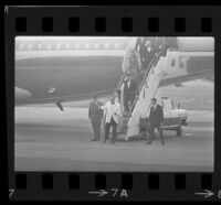 President Johnson, daughter Lynda Bird and Vice President Hubert Humphrey (among others) deboard Air Force One, 1967.