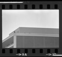 Sniper and lookout atop Century City building in anticipation of President Johnson' arrival, 1967.