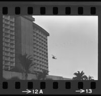Helicopter flies near Century Plaza Hotel before President Johnson's arrival, 1967.