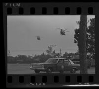 Police car and helicopters near Century Plaza prior to President Johnson's visit, 1967.