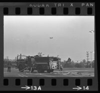 Firefighters watch from their fire truck as President Johnson's helicopter approaches Century Plaza, 1967.