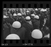 Police arrest protesters outside of Century Plaza during President Johnson's visit as reporters watch, 1967.