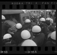 Protesters pushed into police patrol wagon after being arrested for demonstrating at Century Plaza during President Johnson's visit. A. 1967.