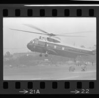 Firefighters duck as President Johnson arrives via helicopter at Century Plaza, 1967.